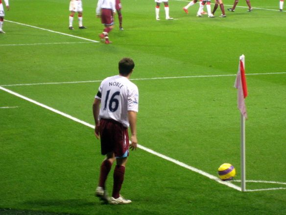 Mark Noble, preparing to launch a cross into a penalty area populated mainly by sentient socks. Possibly.