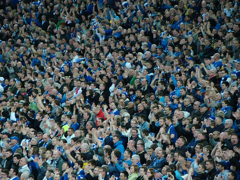 Cardiff fans at the 2012 League Cup final, wearing their traditional colours of not red.